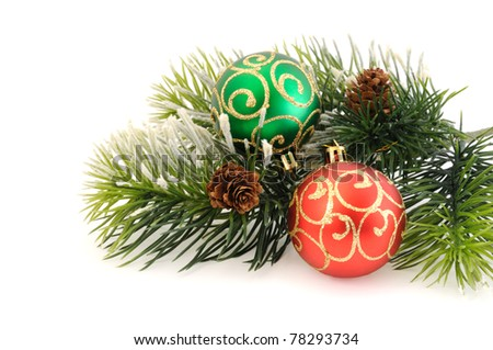 Christmas balls against the backdrop of tinsel with pine branches and cones