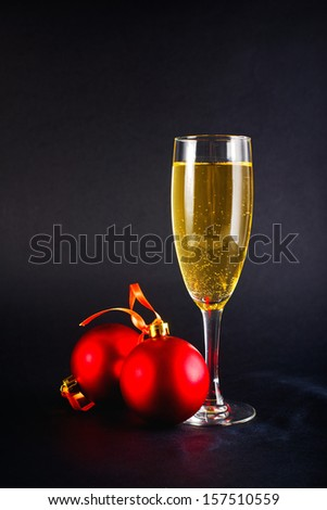 Christmas Balls and glass of white wine. New Year\'s Eve decoration.