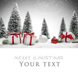 Christmas balls,gift boxes and fir tree on snow