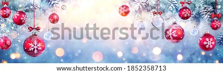 Photo of  Christmas Balls Hanging Fir Branches With Lights In Abstract Defocused Background
