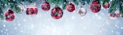 Christmas balls hanging on fir branch