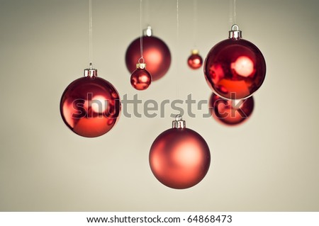 Christmas balls hanging on white background