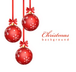 Christmas balls hanging with ribbon bows and snowflakes on white background