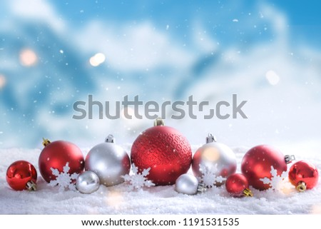 Christmas balls in winter setting,Winter holidays background. - Shutterstock ID 1191531535
