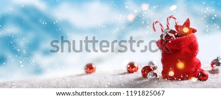 Christmas balls in winter setting,Winter holidays background. - Shutterstock ID 1191825067