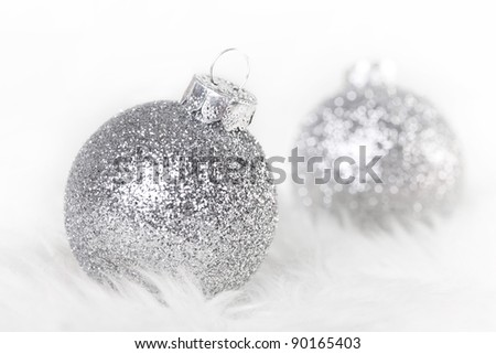 Christmas balls on a white fur