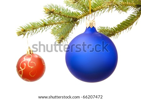 Christmas balls on pine branch isolated on white background.