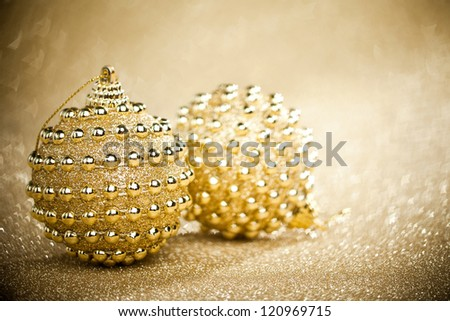 Christmas balls on sparkles background - stock photo