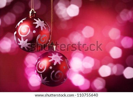 Christmas balls over red background.