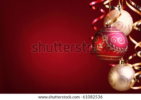 Christmas balls,streamers over red background with copy space.