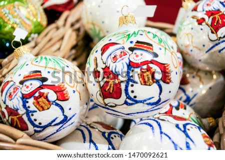 Christmas balls with Santa Claus. Christmas tree decorations and decorations in the design.