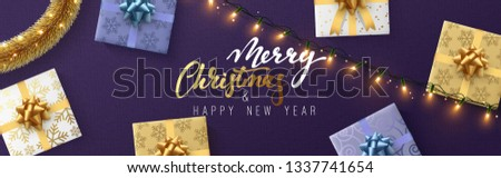 Christmas banner, Xmas sparkling lights garland with gifts and golden tinsel. Christmas posters, cards, headers website. #1337741654