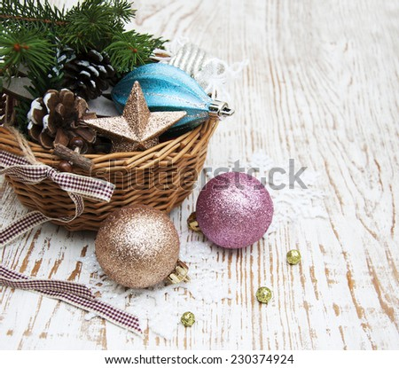 Christmas basket with toys on a wooden  background #230374924