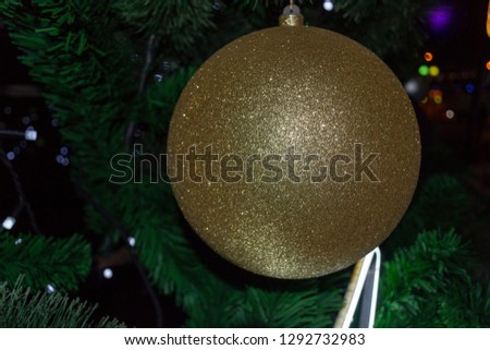 Christmas Bauble Coloured and Shiny on a Pine Tree in Winter Celebrations #1292732983