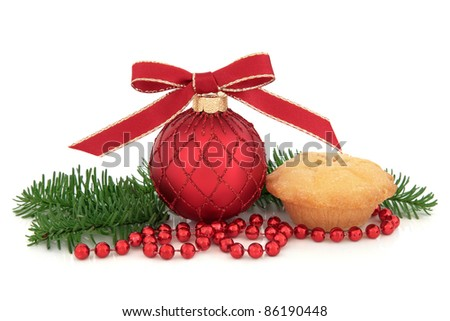 Christmas bauble decoration, with mince pie and pine fir leaf sprigs and strand of beads  isolated over white background.