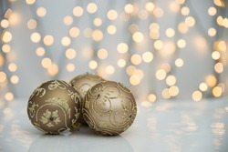 Christmas bauble with christmas tree lights on white background.