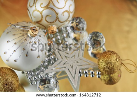 Christmas baubles, Cristal sphere and star golden background with reflections