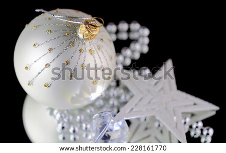 Christmas baubles, Cristal sphere and star on black background with reflections