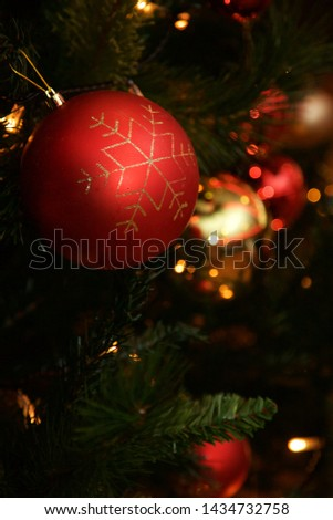 Christmas baubles hanging on the tree. #1434732758