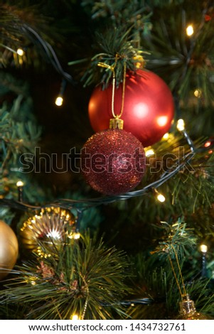 Christmas baubles hanging on the tree. #1434732761