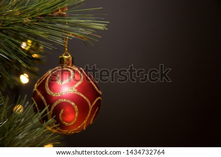 Christmas baubles hanging on the tree. #1434732764