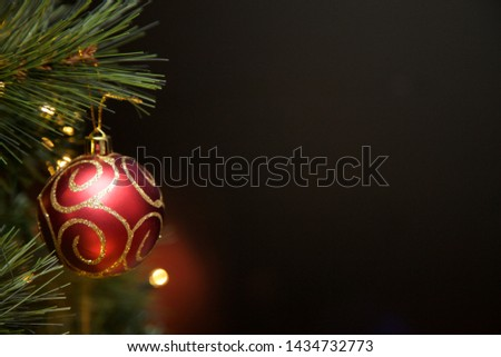 Christmas baubles hanging on the tree. #1434732773