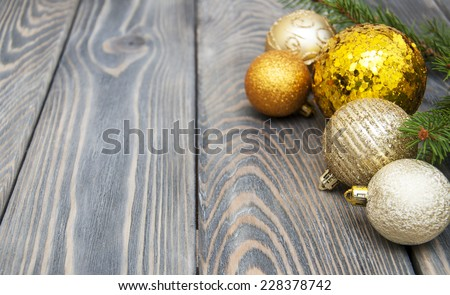 christmas baubles  on a rustic wooden background #228378742