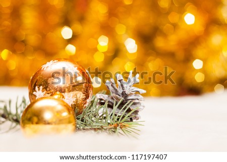 Christmas baubles on background of de focused lights