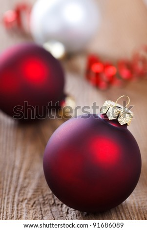 christmas baubles on weathered wooden board