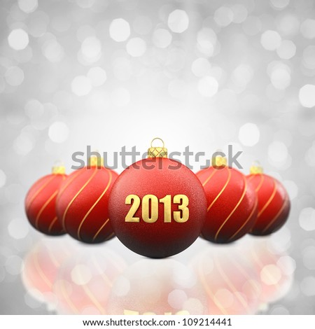 Christmas baubles on white glittery background,2013