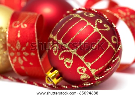 Christmas baubles with curly ribbon isolated on white