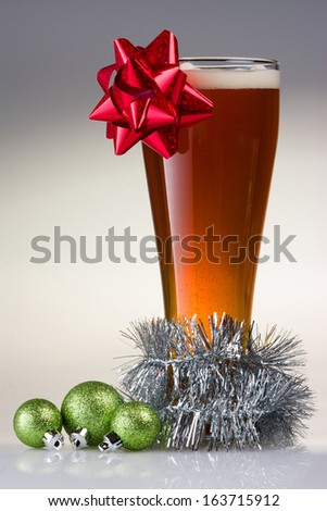 Christmas Beer with a Bow, garland, and Ornaments
