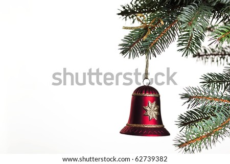 Christmas bell hanging on a christmas tree, on white background isolated, a lot of copyspace available #62739382