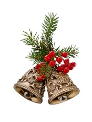 Christmas bells decorated with fir branches and berries isolated on a white background