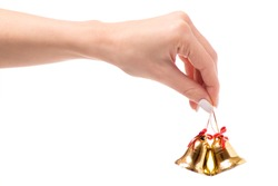 Christmas bells in hand on a white background