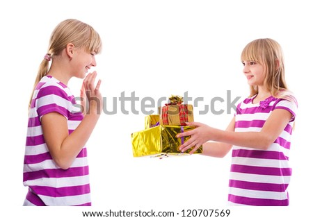 Christmas/Birthday gift -Girl giving gifts to another girl isolated on white background
