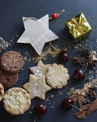 Christmas biscuits, fruit mince pie, choc chip cookies with cherries and spices