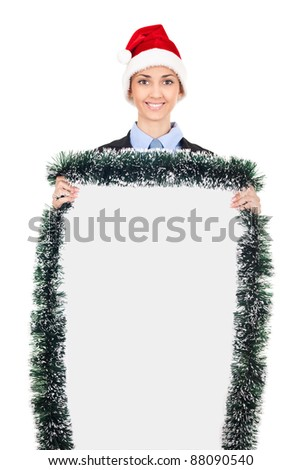 Christmas blank billboard holding smiling businesswoman, isolated on white