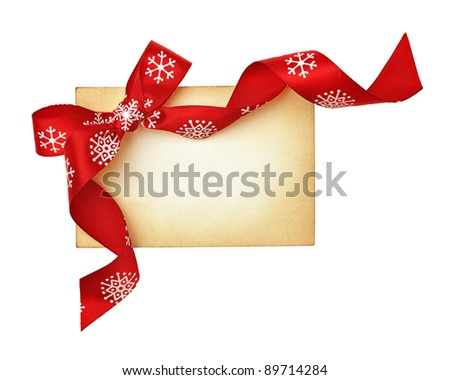 christmas blank gift tag tied with a bow of satin ribbon. Isolated on white - stock photo