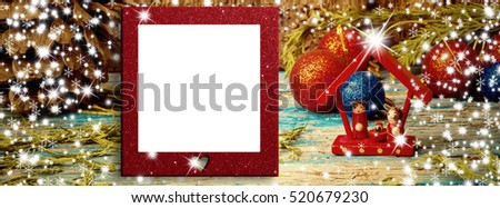 Christmas blank photo frame card, Christmas decorations and small Nativity Scene on glitter background