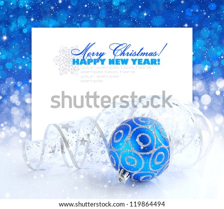 Christmas blue and silver decorations on festive background a postal with sample text