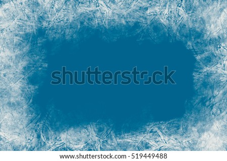 Christmas blue background with frozen pattern.Empty space for text,poscards.