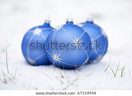 Christmas blue ball on a white snow