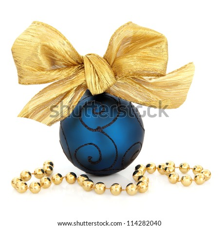 Christmas blue bauble with gold bow and bead chain over white background.