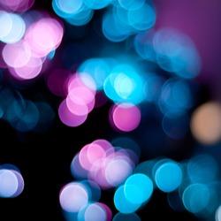 Christmas blurred lights background. Defocused lights background. Bokeh sparkling lights. Abstract colorful background.