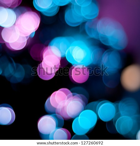 Christmas blurred lights background. Defocused lights background. Bokeh sparkling lights. Abstract colorful background.
