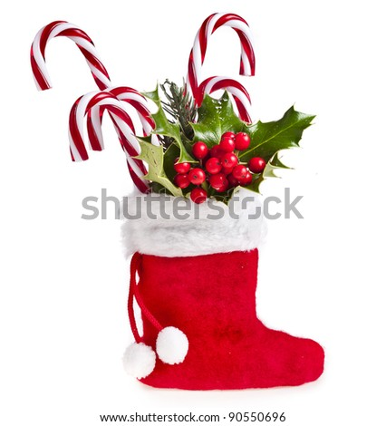 christmas boot stocking with gifts  on white background