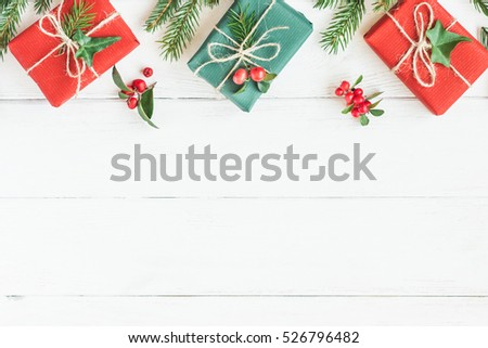 Christmas border. Christmas gifts, fir branches. Flat lay, top view