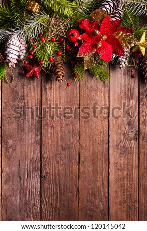 Christmas border design on the wooden background