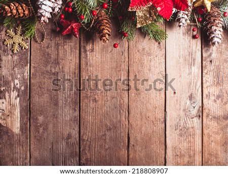 Christmas border design on the wooden background #218808907